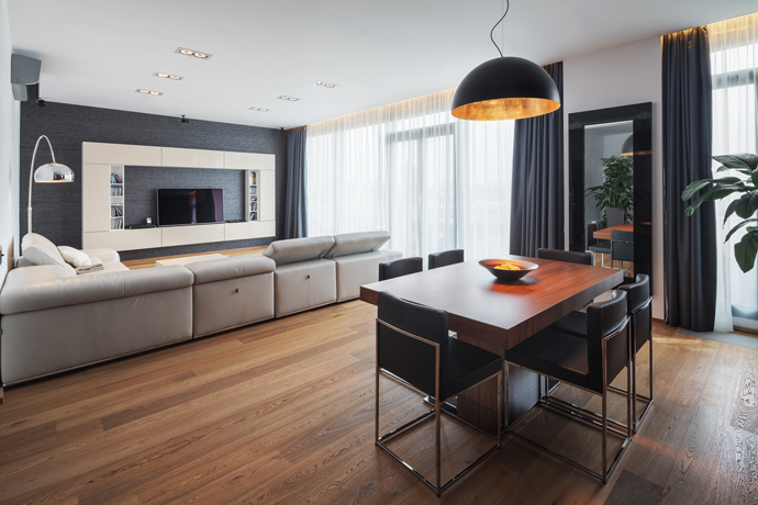 Sleek Beige Living Room In Brown Wood Flooring With Grey Wall Accent HouseBeauty