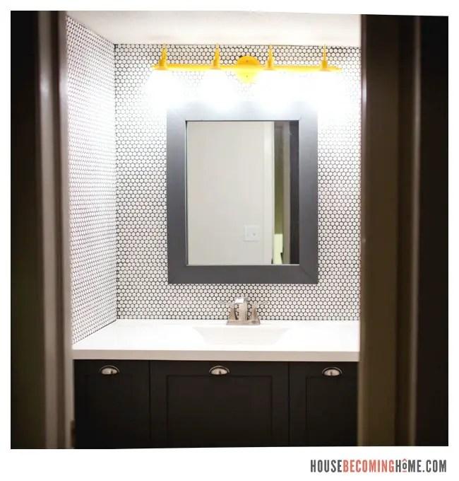 DIY bathrrom mirror on penny tile