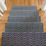 Dash and Albert stair runner on oak stairs