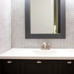 Full wall of white penny tile in a bathroom