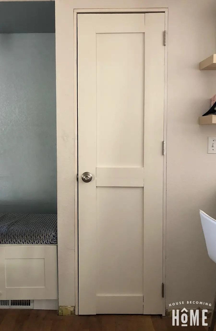 door frame and door installed without trim