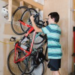 Easy and Cheap DIY Bike Rack. Keep bikes organized while saving space in your garage with this DIY bike rack that costs $10 to make!