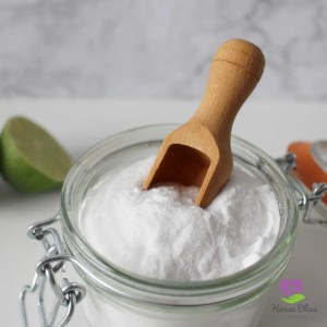 a jar with baking soda and a wooden scoop