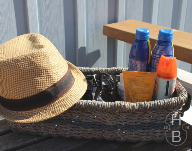 Basket of extra sunglasses, sun block and hats for outdoor parties | Tips for Outdoor Entertaining | House by the Bay Design