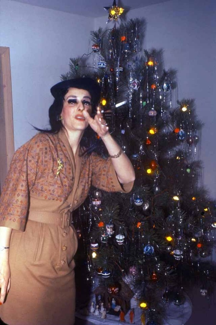 Woman in front of vintage Christmas tree