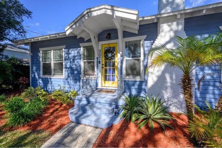 blue Craftsman bungalow in Florida