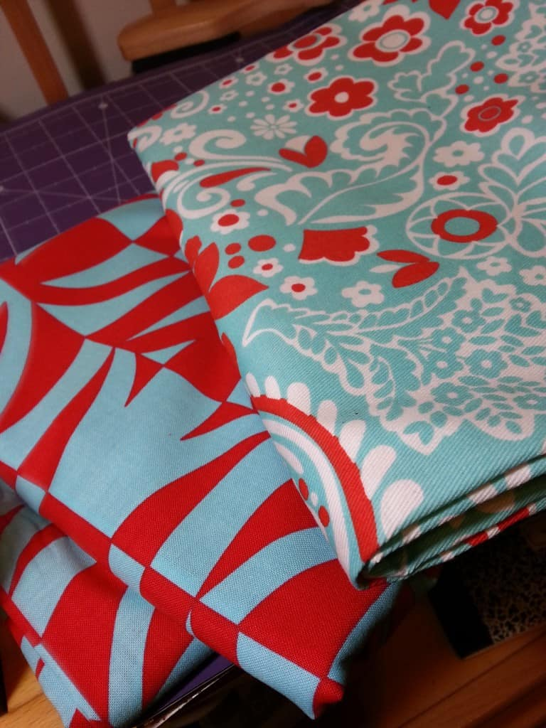 Amy Butler's Sophia Carry-All in red and teal blue fabric.
