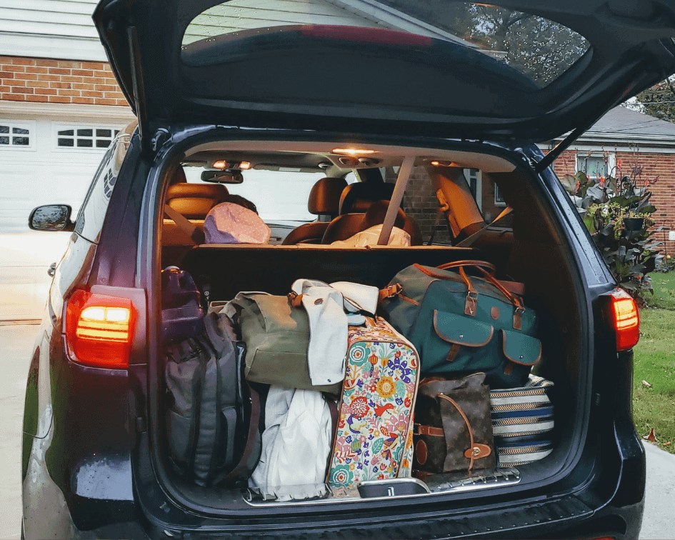 The Kia Sedona trunk is DEEP and spacious. More than enough room for a six or seven person family.