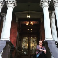 Sitting on the steps of Kehoe House.