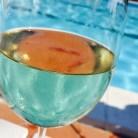 Arty poolside wine shot.