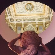 A sculpture in the Museo Nazionale looks up at the mural on the ceiling above.