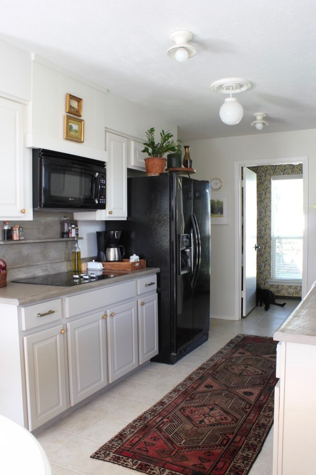budget friendly kitchen makeover: disguise soffit with trim and faux vent hood