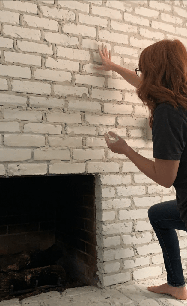 press in mortar on over grouted fireplace