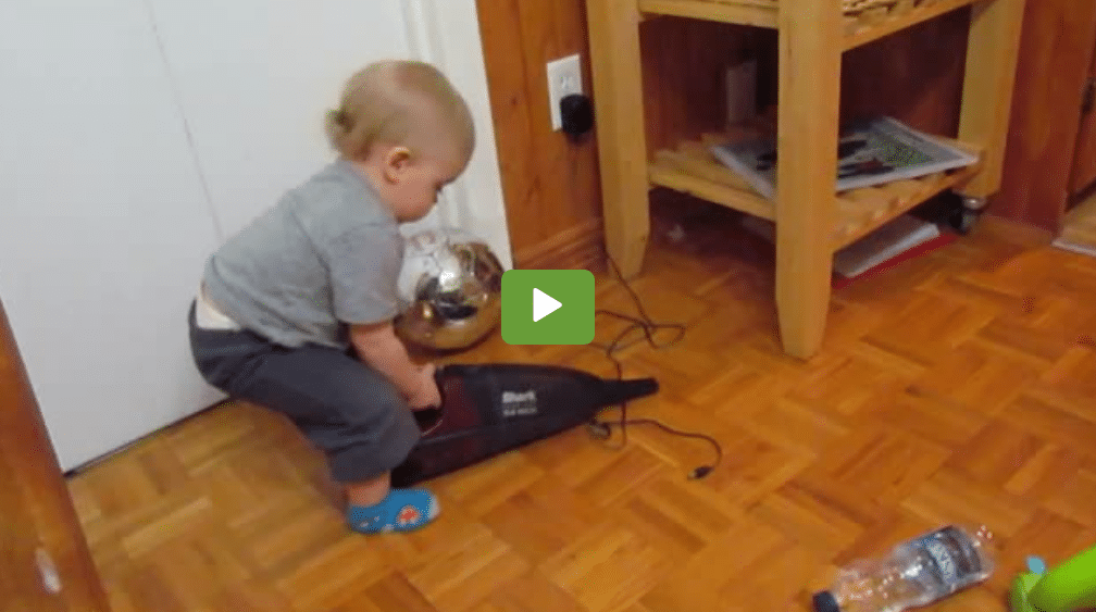 Baby Doesn't Know How To React When Dust-Buster Turns On