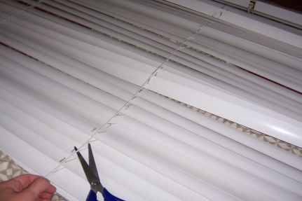 Taking the slats off by cutting the ladder threads.