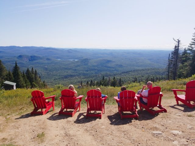 top of the summit mont tremblant red chairs