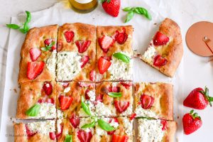 sliced strawberry pizza bianca with herbed ricotta