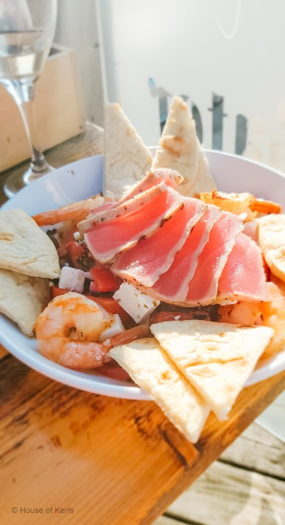 The Nisyrian Salad topped with Ahi Tuna with the best beach & sunset views in town at The Growling Gator