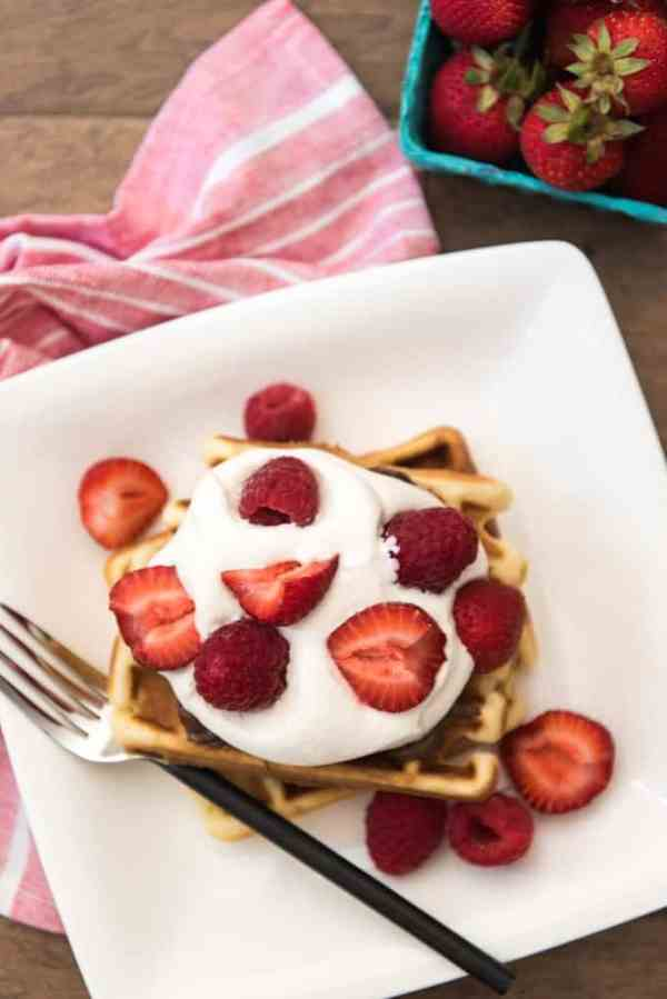 These Belgian waffles are crisp on the outside and soft on the inside - perfect for topping with nutella or syrup or your favorite fruit with fresh whipped cream. Raspberries are my favorite, but strawberries, blueberries, bananas, or even cinnamon apples are delicious as well. These are perfect for a breakfast or brunch because guests can top their waffle however they want!