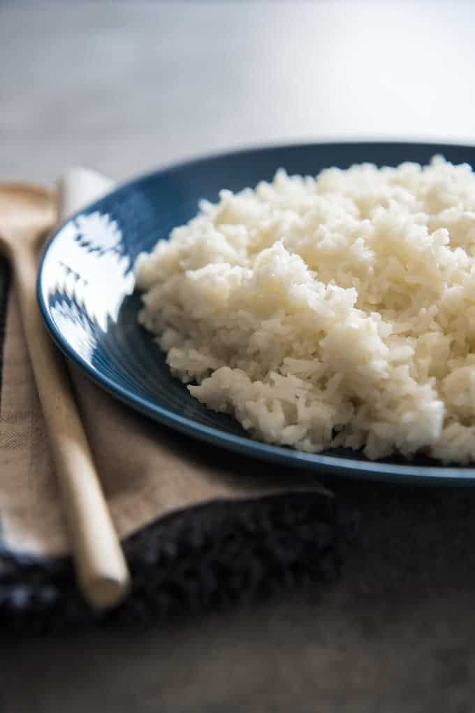 The perfect side dish for a meal or even just on its own topped with spiced black beans, Brazilian White Rice is seasoned with onions and garlic and is absolutely delicious. It will replace boring, plain white rice in your home and you will never want to go back.