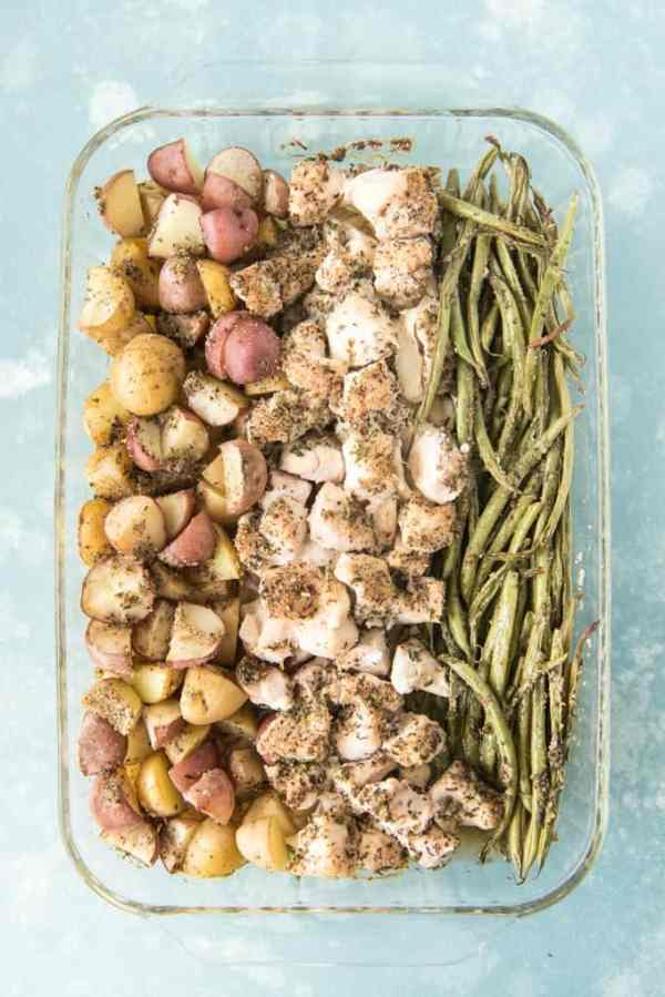 This easy one pan green bean, chicken & potato dinner takes no time to throw together and you don't have to dirty dozens of dishes to do it! The savory herbs on buttery bites of roasted potatoes, chicken & green beans are sure to satisfy a hungry family and make this easy weeknight dinner a winner that you will want to make over and over!