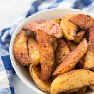 Big, bold barbecue flavors make these oven roasted barbecue potato wedges an incredibly delicious side to any meal. They are seasoned perfectly with a crispy exterior and soft, almost buttery insides! Like your favorite BBQ potato chips, they are hard to resist once you get started, so be sure to make an extra large batch!