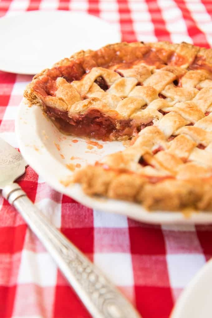 Strawberry Rhubarb Pie has a sweet-tart filling in a flaky, buttery crust that is Springtime pie perfection! Delicious with a scoop of vanilla ice cream!