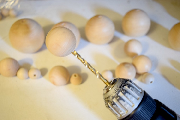 Drill holes in wood spheres