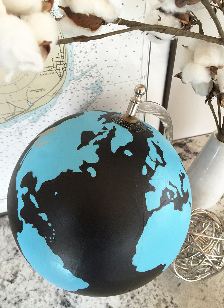 Paint an old globe with bold acrylic paint and a Sharpie pen to create a chic decoration