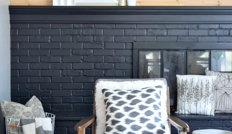 How To Paint Your Brick Fireplace Black And Never Look Back