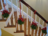 christmas decorations banister topiaries on the stairs