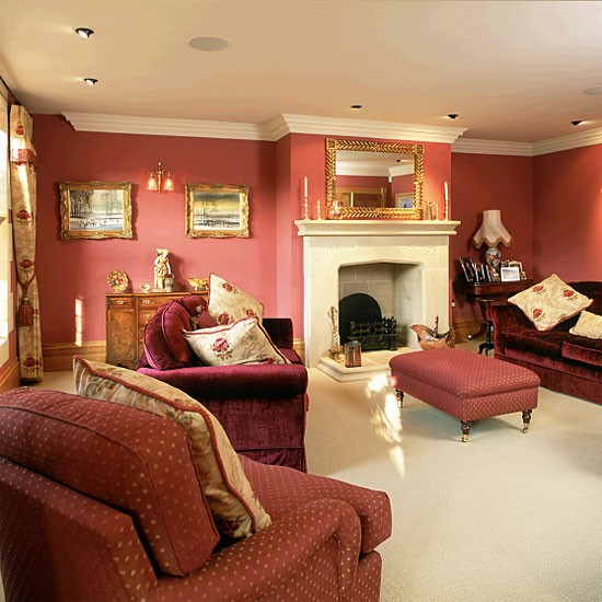 Living room with red walls and sofas  housetohomecouk