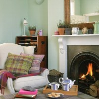 Living room with fireplace, armchair and tartan ...
