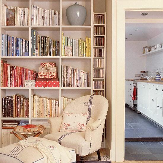 Living room with bookshelves and armchair  housetohomecouk