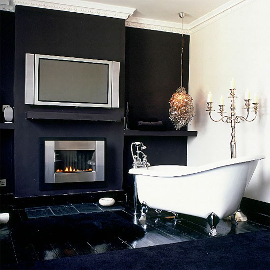 Monochrome bathroom with flatscreen TV and fireplace  Technology in the bathroom  housetohome
