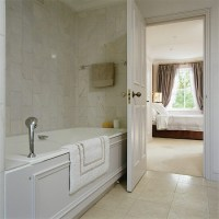 Ensuite bathroom with marble tiling | housetohome.co.uk
