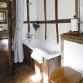 Small white and pine bathroom with exposed beams