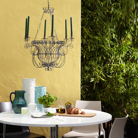 Yellow painted exterior walls  Colourful garden ideas