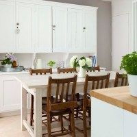 Dining table in kitchen   Elegant and contemporary house ...