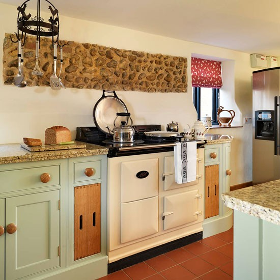 Aga  Soft green and cream traditional kitchen