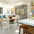 An open plan layout provides enough space for a dining table and a