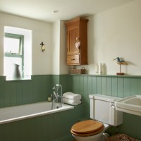 Country bathroom with tongue-and-groove panelling ...