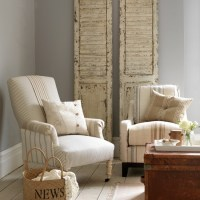 Neutral living room with ticking armchair | housetohome.co.uk