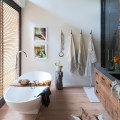 This modern bathroom has a nautical feel with its quirky rope blind