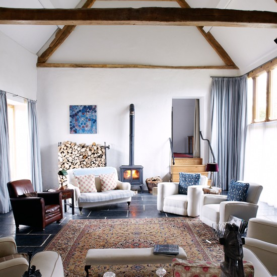 Warm and inviting country living room with original beams  Living room decorating  housetohome