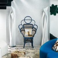 White living room with blue rattan chair
