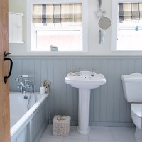 Grey and white country bathroom with wall panels ...