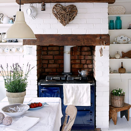 Country kitchen with brick fireplace and blue Aga  Kitchen decorating  housetohomecouk