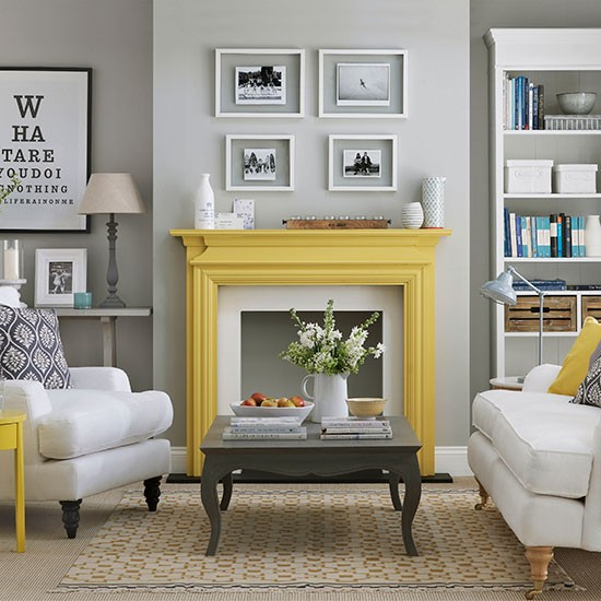 Pale grey living room with yellow fireplace