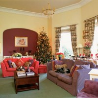 Christmas living room with coloured sofas | Christmas ...